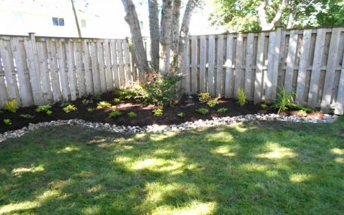 Backyard Garden Bed with River Stone Border1