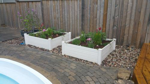 Raised Garden Bed Design with River Stone