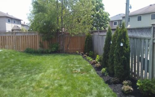 backyard fence garden installation 2