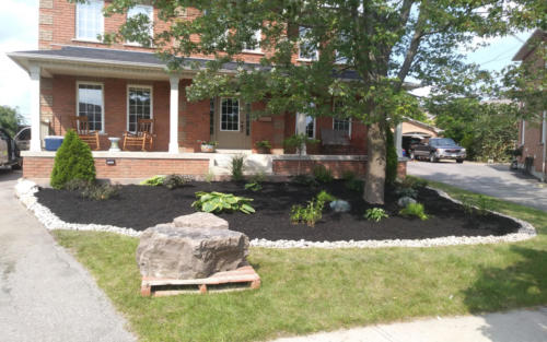 front garden bed design with river stone edge 1