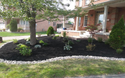 front garden bed design with river stone edge 2