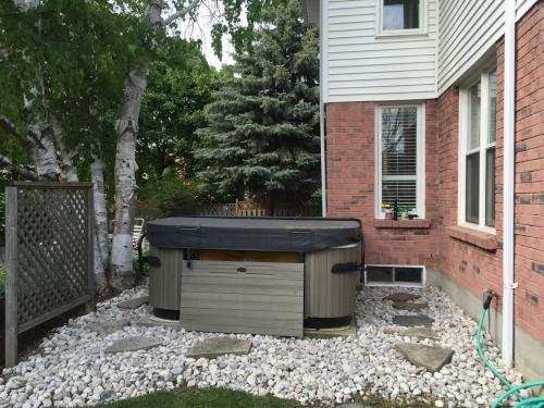 Backyard Hot Tub Design Idea River Stone