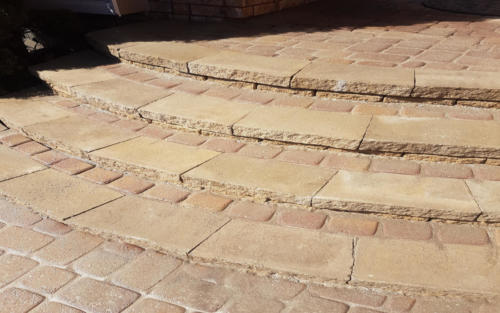 front entrance curved stone steps