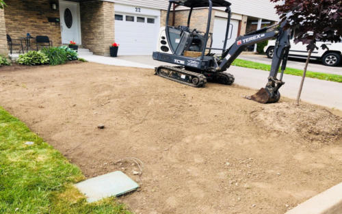 front entrance sod grading before 2